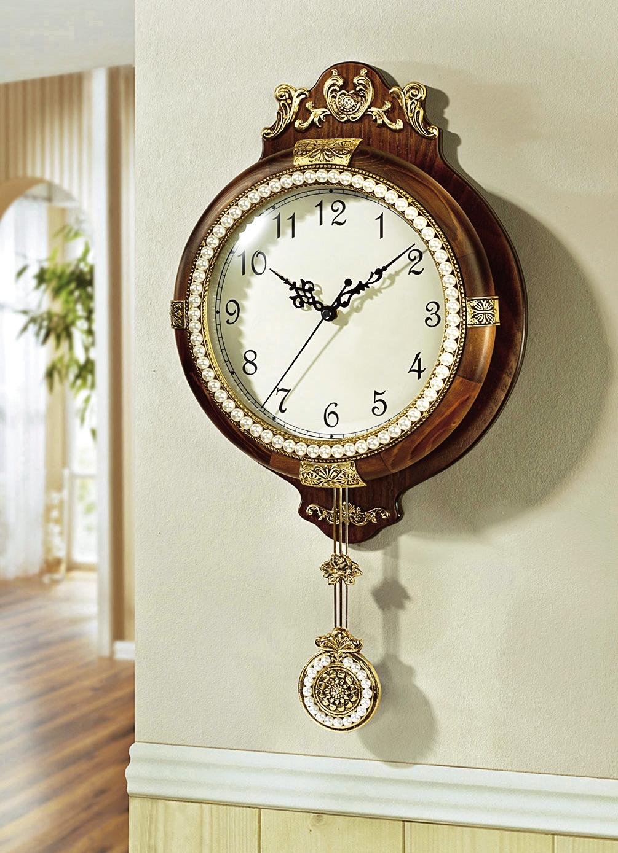 wanduhr mit ornamente und perlenverzierungen uhren bader. Black Bedroom Furniture Sets. Home Design Ideas