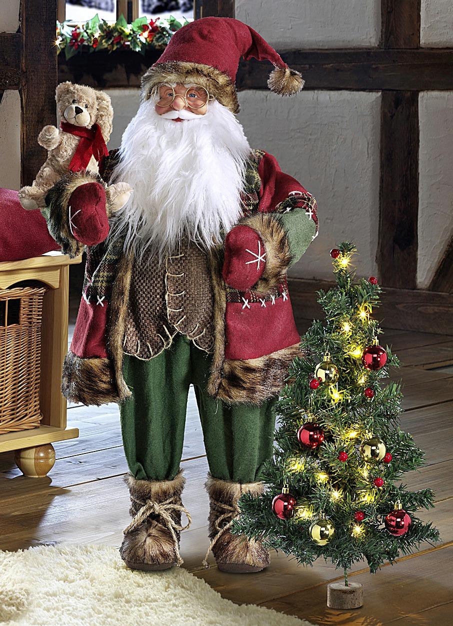 weihnachtsmann mit weihnachtsbaum weihnachtliche. Black Bedroom Furniture Sets. Home Design Ideas